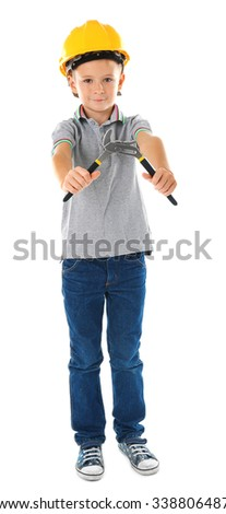 Little boy in yellow helmet with building equipment isolated on white background - stock photo