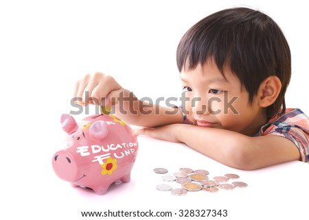 Little boy insert coin into piggy bank with education fund text on white background - stock photo