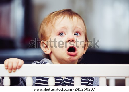 Little boy is crying in the bed - stock photo