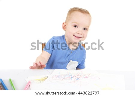 Little boy is drawing the picture - stock photo