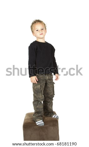 Little boy is posing for the camera - stock photo