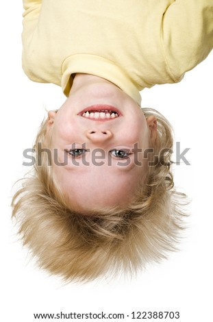 little boy is upside down on white background - stock photo