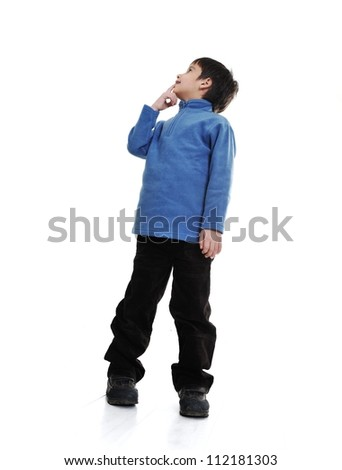 Little boy isolated on white looking up - stock photo