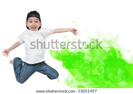Little boy jumping on isolated white background with green paint blob - stock photo