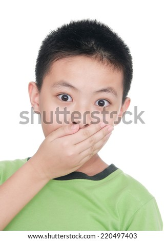 little boy keeping silence by covering his mouth by hands - stock photo