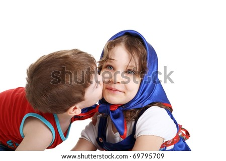 little boy kissing his pretty little sister in headscarf - stock photo
