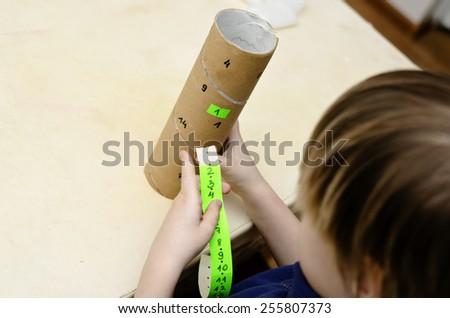 Little boy learning math of Montessori - stock photo
