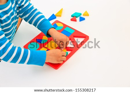little boy learning shapes, early education and daycare concept - stock photo