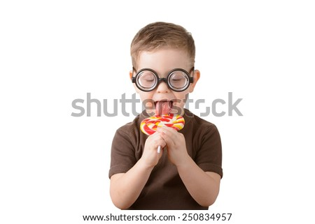 little boy licking lollipop with glasses on a white background - stock photo