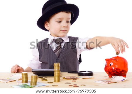 Little boy like a boss at the table counts money, isolated on white - stock photo