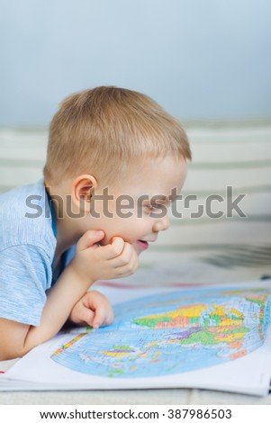 Little boy looking at map  - stock photo