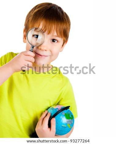 little boy looking through a magnifying glass - stock photo