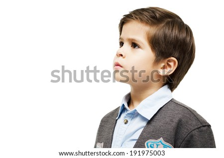 Little boy looking up on white background - stock photo