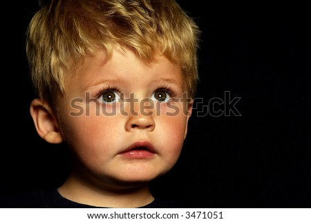 little boy lookinging up - stock photo