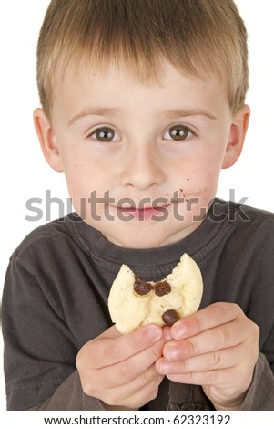 Little Boy loves homemade allergen free cookies - stock photo