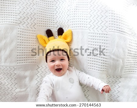 little boy lying on soft white blanket - stock photo