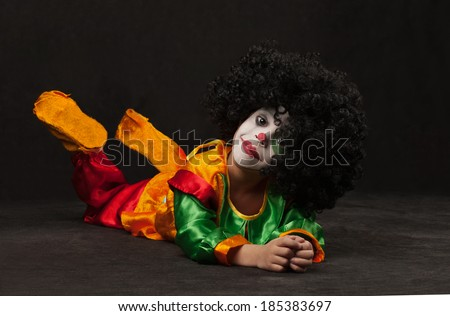 little boy, make-up of the clown, the African - stock photo