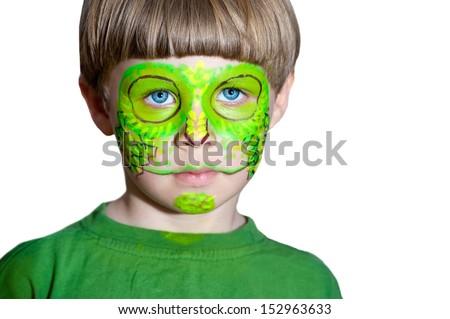 Little boy making face painting. Halloween.Chameleon - stock photo