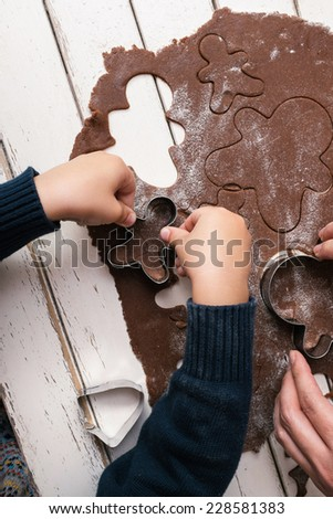 Little boy making gingerbread men - stock photo