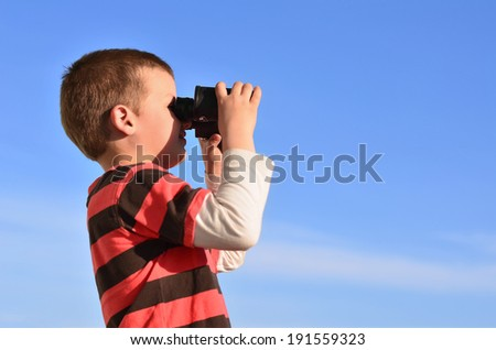 Little boy observing surroundings in midday - stock photo