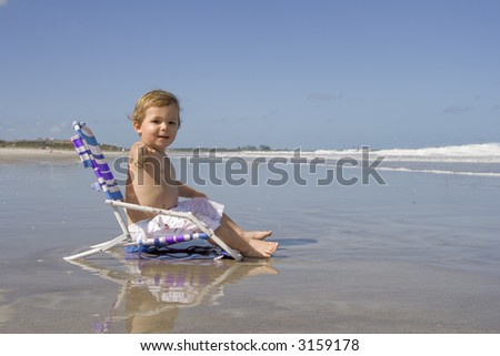 Little boy on a beach - stock photo