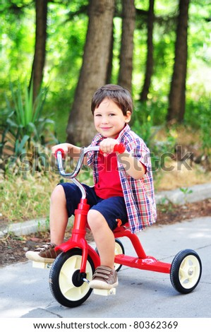 Little boy on a bicycle - stock photo