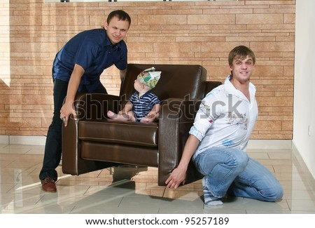 little boy on a leather couch - stock photo
