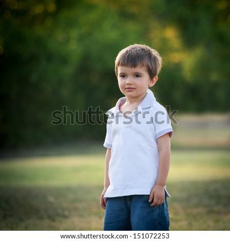 Little boy outdoors portrait.  - stock photo