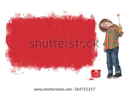 Little boy painting a red banner on the wall  - stock photo