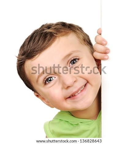 Little boy peeking - stock photo