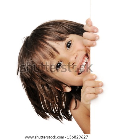 Little boy peeking from behind the adver - stock photo