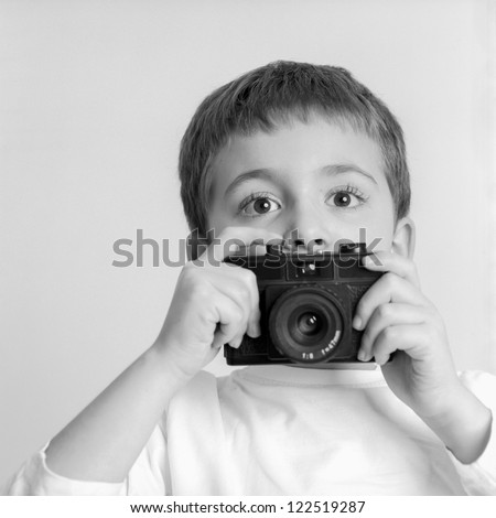Little Boy Photographer - stock photo