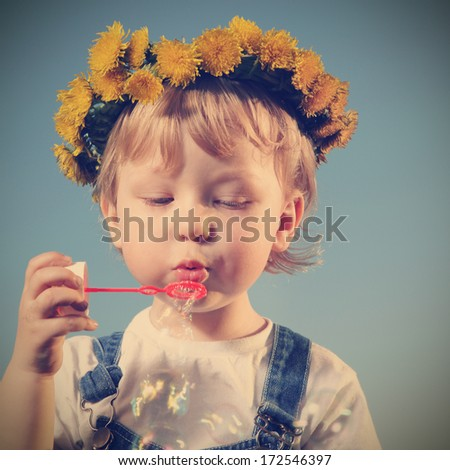 little boy play bubbles outdoors - stock photo