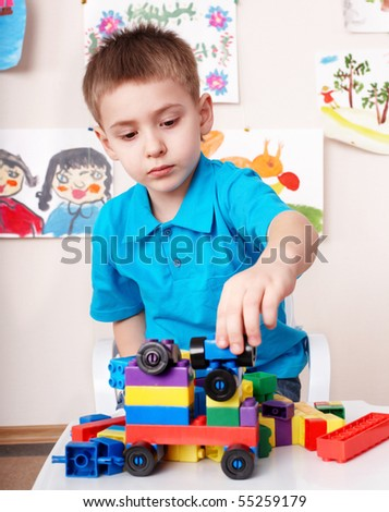 Little boy play construction set at home. - stock photo