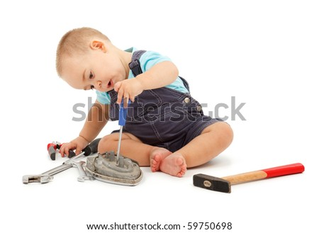 Little boy playing and working with real toys - stock photo