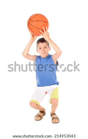 little boy playing basketball isolated in white - stock photo