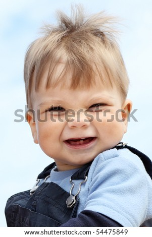 Little boy playing by the sea in summer - stock photo