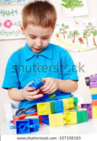 Little boy playing construction set. - stock photo