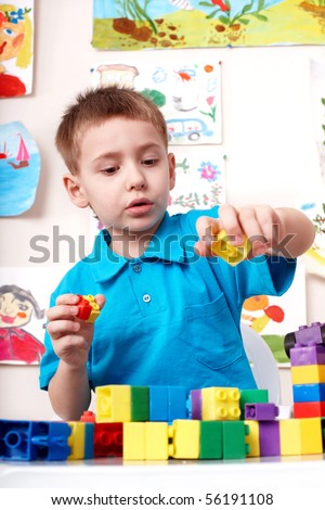 Little boy playing construction set . - stock photo
