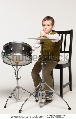 little boy playing drum and cymbals - stock photo
