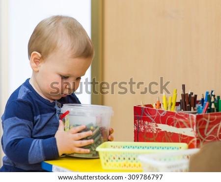 little boy playing in a kindergarten - stock photo