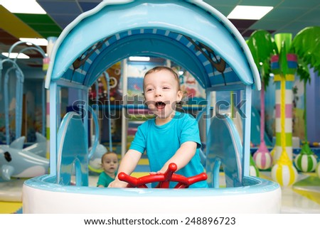 little boy playing in the entertainment center - stock photo