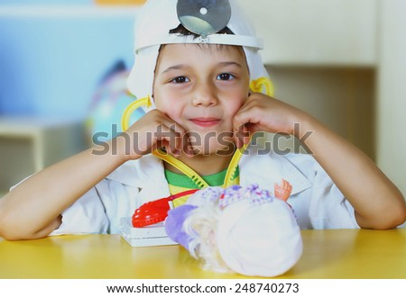 Little boy playing in the hospital - stock photo