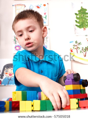 Little boy playing lego block and construction set. - stock photo