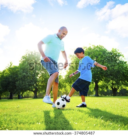 Little Boy Playing Soccer With His Father Concept - stock photo