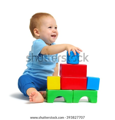 Little boy playing toy isolated on white background - stock photo