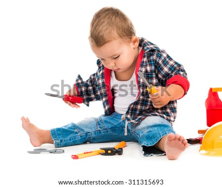 little boy playing toy tools isolated on white background - stock photo