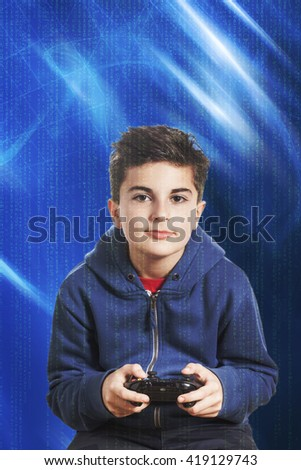 Little boy playing videogame - stock photo