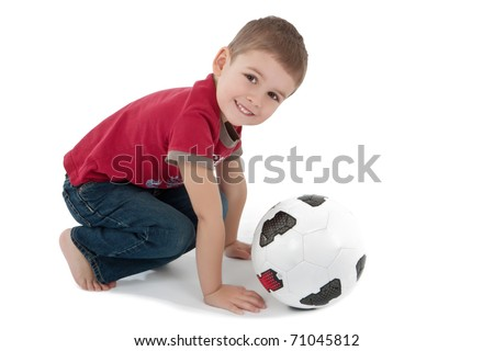 Little boy playing with a soccer ball - stock photo