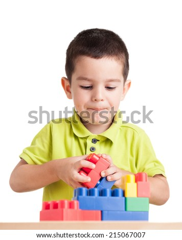 Little boy playing with blocks. Isolated on white - stock photo